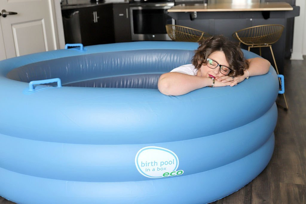 Woman laying on the side of a birth pool